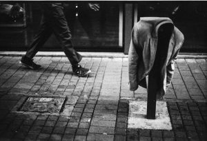 From an ongoing body of work focusing on fragments of solitude. An unidentified man walking along a street in Braamfontein, Johannesburg RSA.